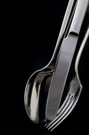 spoon, knife and fork in black background Stock Photo