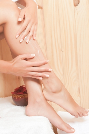 woman legs in a sauna or spa