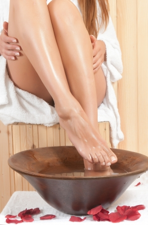 beautiful woman legs in a sauna or spa