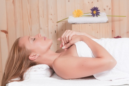 sexual chakra: beautiful blonde woman having relax in an spa or sauna Stock Photo