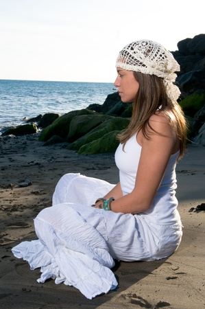 woman in yoga position at the seaside photo