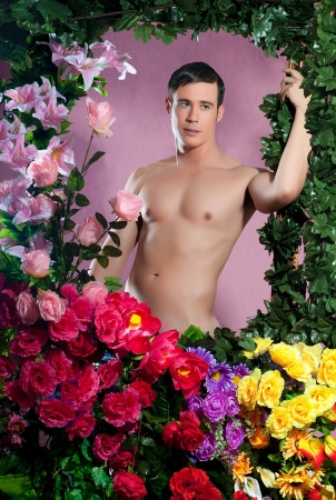 gay with flowers in a pink background