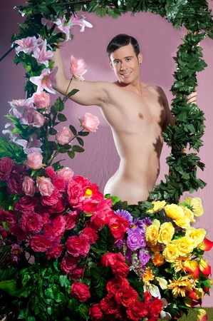 guy with flowers in a pink background