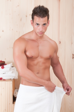 beautiful man in a sauna with towel