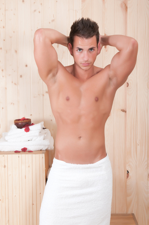 sport man in a sauna with towel photo