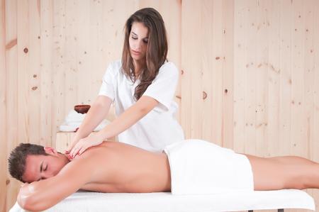 ttractive: beautiful man in sauna getting massage