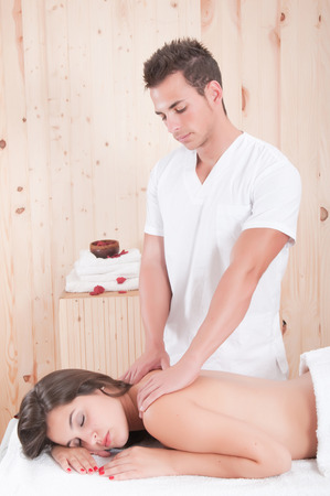 ttractive: young woman in spa getting massage