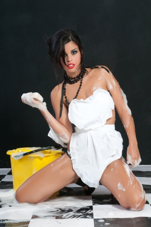 exempted female: sexy woman washing the floor Stock Photo