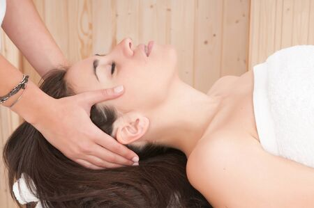 woman in spa getting a massage on her face photo