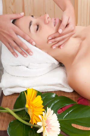 woman having a cosmetic treatment in spa photo