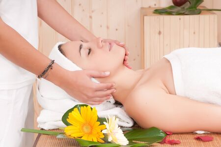 beautiful woman in spa center having massage photo