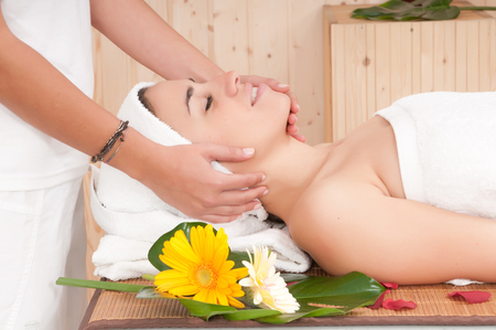 beautiful woman in spa center having massage photo
