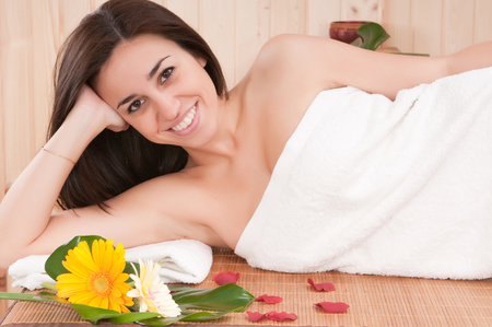 beautiful woman in spa center having relax photo