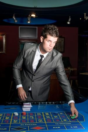 gambler: gambler at a casino table