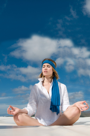 woman under the sky relaxing doing meditation photo