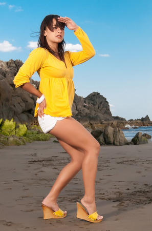 beautiful woman in yellow looking for somebody photo