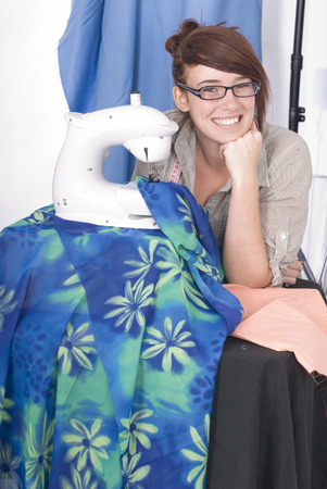 Smiling young woman or seamstress photo