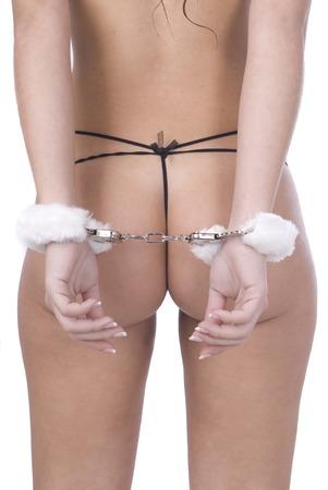 handcuffed: vrouw terug met handboeien in lingerie Stockfoto