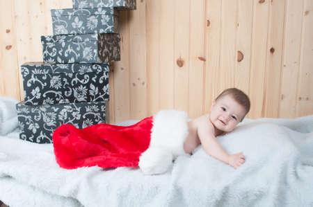Child dressed as Santa Klaus
