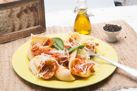shell type pasta dish with meat served on table