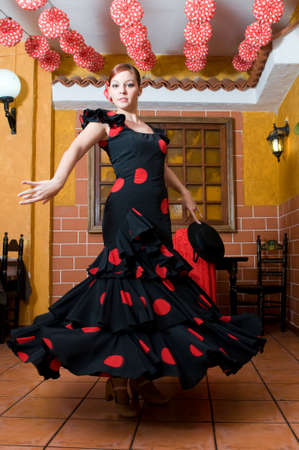 typical Spanish flamenco dancer at the Seville fair in April