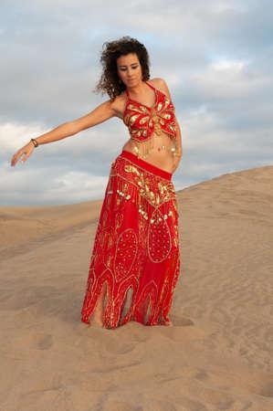 belly dancer in the desert at sunset