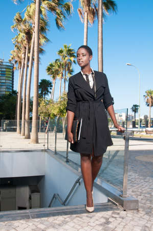 executive black woman in the business area of a city