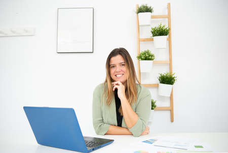 young business woman in her office working
