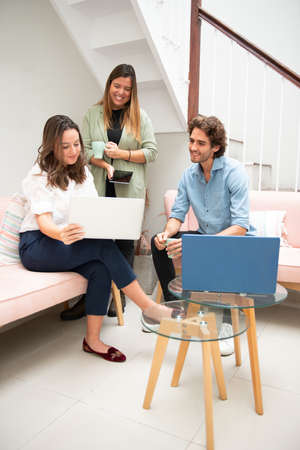 young entrepreneurs in their office working informally on their computers
