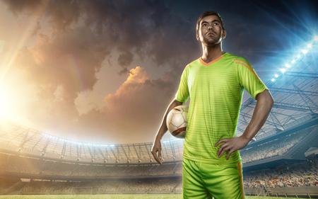 soccer player on a soccer stadium with illumination