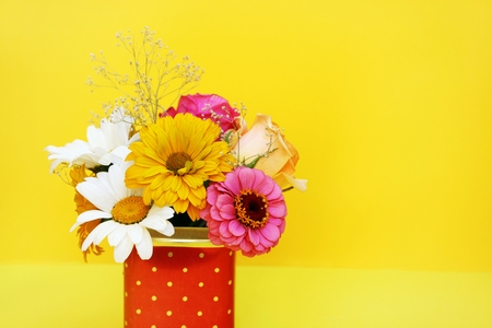 Bouquet of flowers on a yellow background.