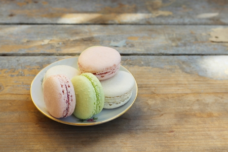 Macaroons on a wooden background
