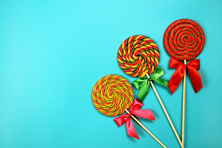 Colorful lollipops on blue background