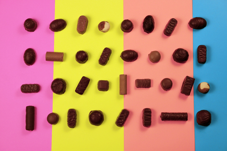Chocolate candies on multicolored background Stock fotó