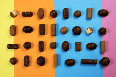 Chocolate candies on multicolored background Stock fotó - 93760841