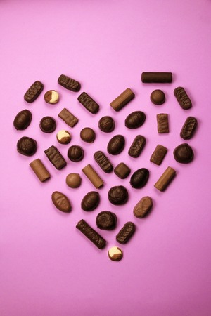 Heart shape made with various types of chocolate.Saint Valentines day concept
