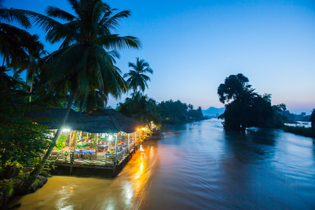Riverside restaurant near Mekong River in twilight. Don Det-Don Khon Island. Champasak Province, Laos. Editorial