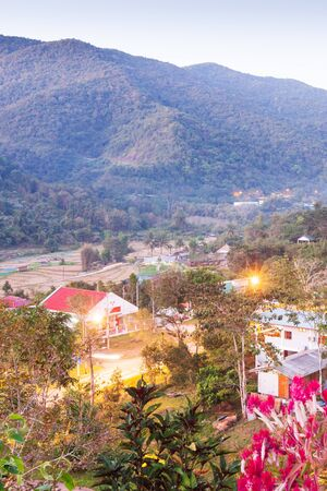 Beautiful view, Bo Kluea District at twilight, mountains backgrounds. The district has grown up two natural saltwater. Salt is still produced in the traditional way in Boklua. Ancient salt pits. Salt culture. History of salt.