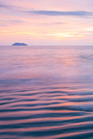 Beautiful gently waves, texture ripple marks in surf. Thailand. Long exposure. Fantastic sunset sky and backgrounds. Summer season. Holidays concept. Фото со стока