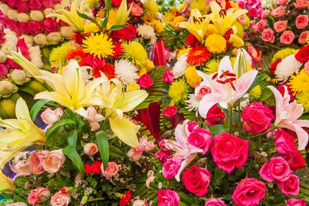 Colorful fresh blossoming flowers, beautiful lily, roses and other flowers at the florist shop shelves on footpath, Phsa Thmei Market, Phnom Penh City, Cambodia.
