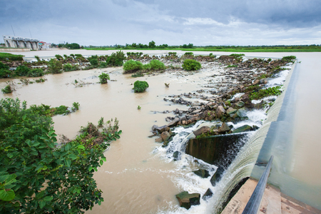 Rainy season, Prek Thnot River or Stung Prek Thnot threatens to overflow. Stung Prek Thnot is a stream in Khett Kandal, Cambodia. Storm is coming over spillway and floodgate. Climate change.