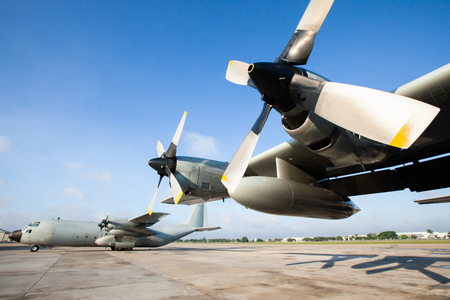 Military transport aircraft on runway at an airport in Asia, are primarily used to transport troops and war supplies.