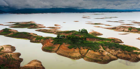 Aerial view of a dam and tropical rainforest flooded. Climate change, Environment concepts.
