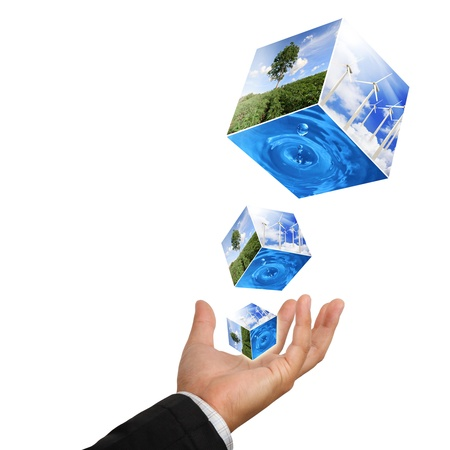 Business man hand holding with nature water drop and wind  turbines farm isolated on white