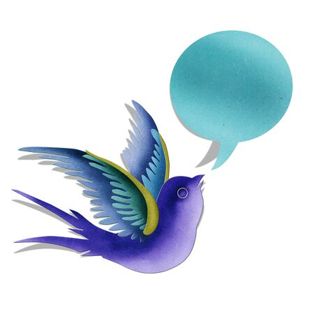 birds in flight: Blue swallow with bubble message created by paper craft isolated on white background Stock Photo