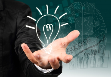 Businessman hand holding light bulb illustration idea concept
