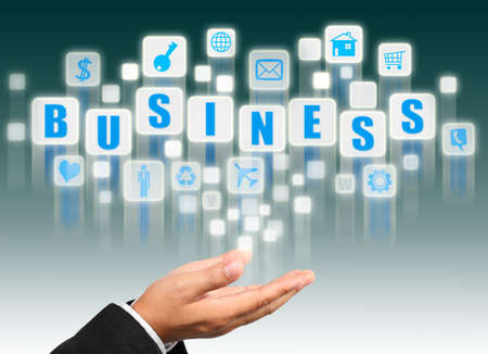 Businessman hand holding with business alphabet streaming images photo