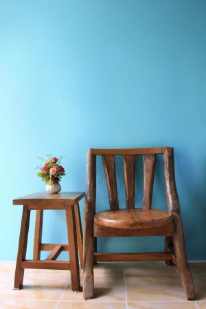 interior design of wood chair on a blue wall