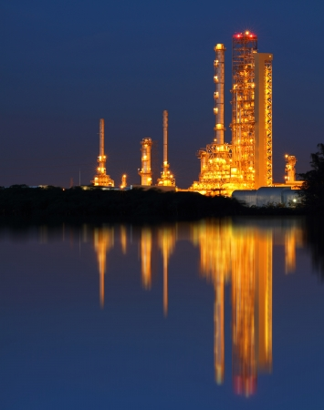 Reflection of gold petrochemical industry on sunset photo