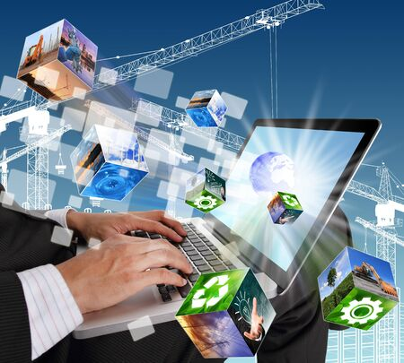 Businessman hands typing on laptop keyboard with industrial and buildings cubes streaming